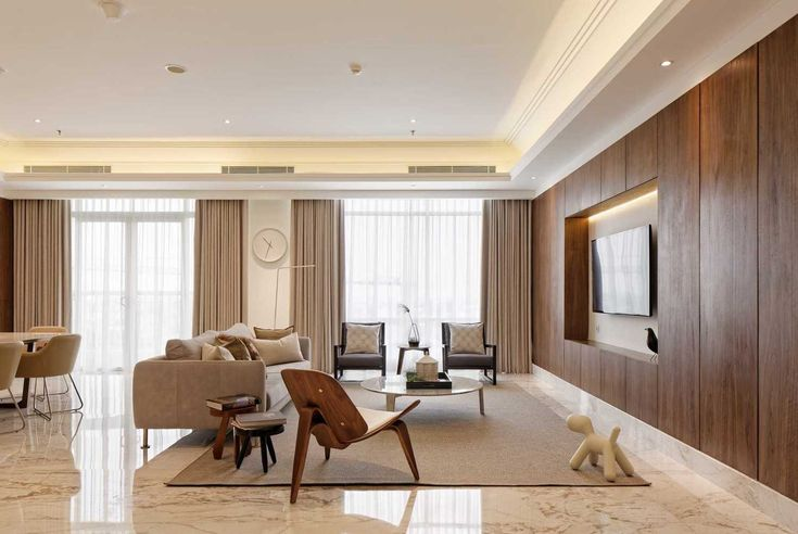 A modern 3 bedroom apartment with walnut wood finish and white marble