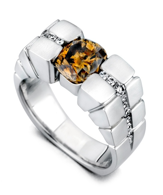 The Adamant ring contains 18 diamonds, totaling 0.33ctw. Shown with 2.41ct chocolate center diamond. Price does not include center stone. Price will vary on size and color of center diamond.