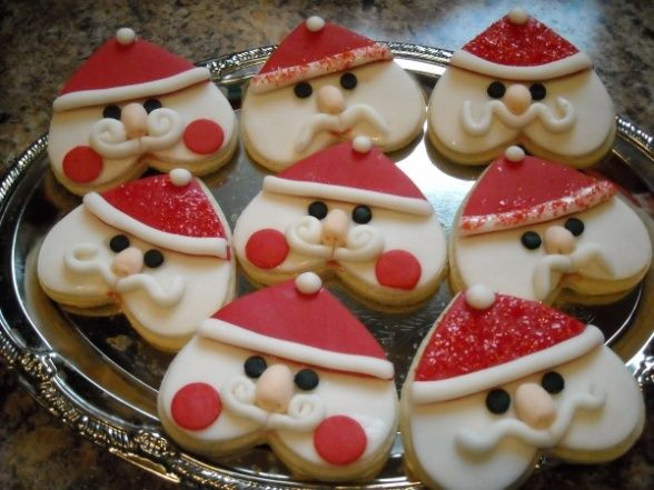 Santa cookies made with a heart cookie cutter