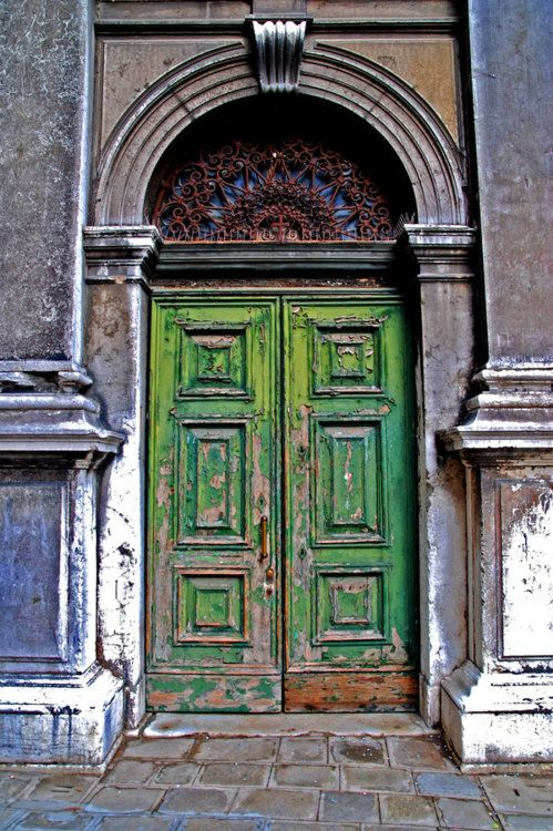 "Doorway.  Venice, Italy.     ""In the universe, there are things that are known, and things that are unknown, and in between, there are doors.""  ― William Blake"