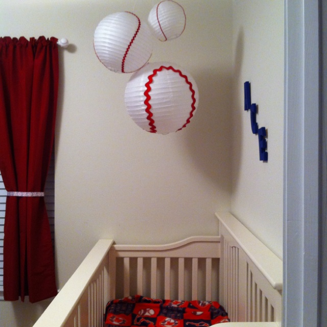 Homemade baseball lanterns, red curtains with baseball ribbon and baseball curtain rod ends!