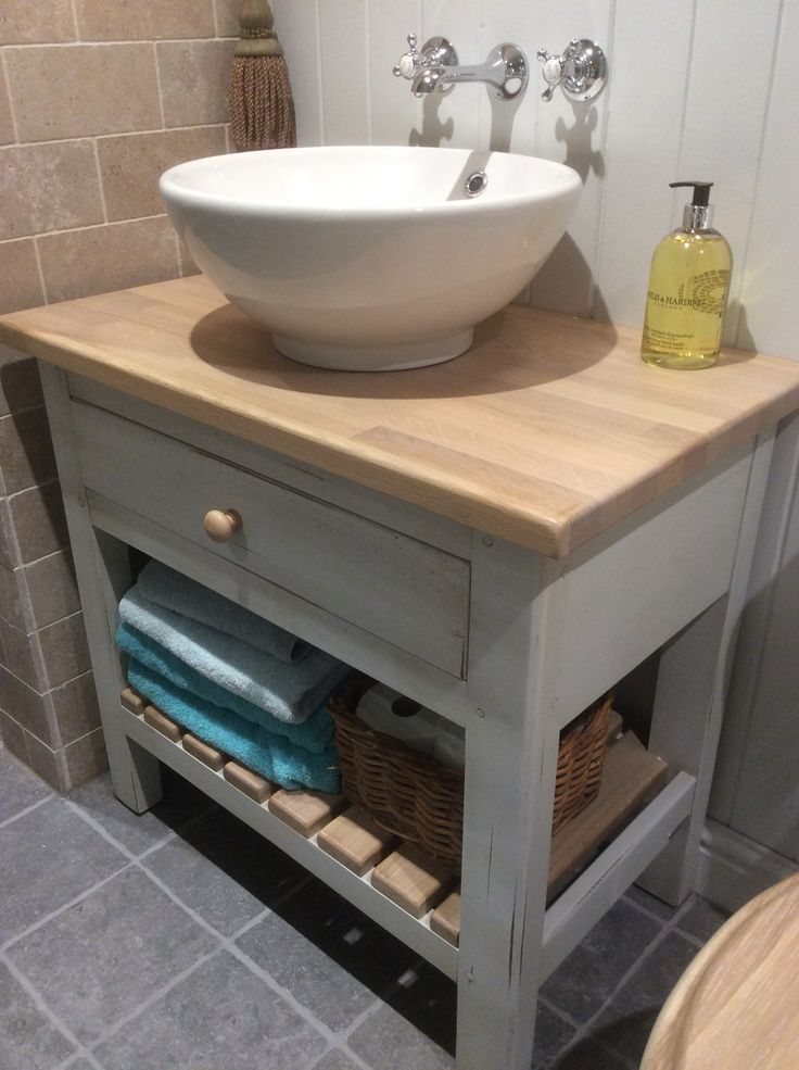 Fired Earth washstand with Imperial Bathrooms wash bowl.Fired Earth tiles.