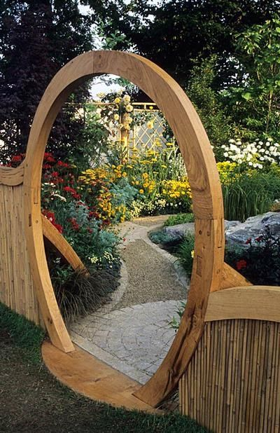 20 Beautiful Garden Gate Ideas. Path on the other side of gate. Whimsical. Winding. Flowers.
