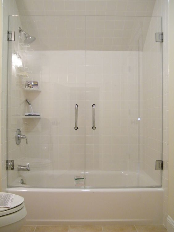 Frameless Glass Tub Enclosure. Framless glass doors on your bath tub can be designed and installed as an alternative to conventional sliding doors with tracks. You are looking at 2 tempered glass doors that open up completely-- clearing the toilet bowl with maximum access to the bath tub, making cleaning incredibly easy... and simplifying your life!: