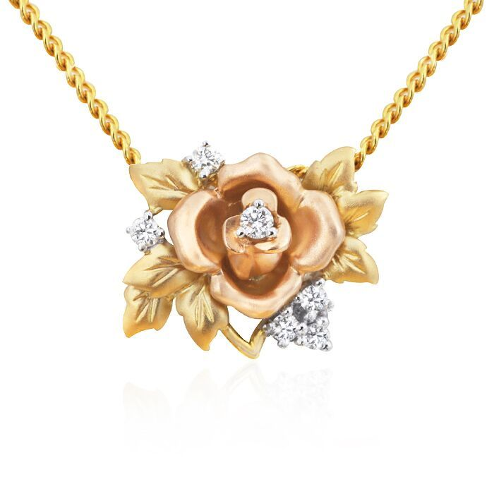 Rose floral pendant set with six diamonds in 18ct multi toned gold. Total diamond weight = 0.10ct. Chain sold separately. This pendant measures approximately 17mm wide and 12mm long.