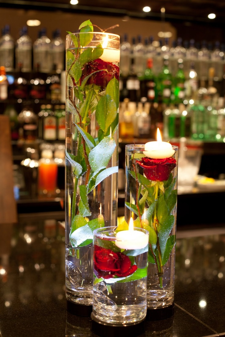 Roses in water x4 on each table