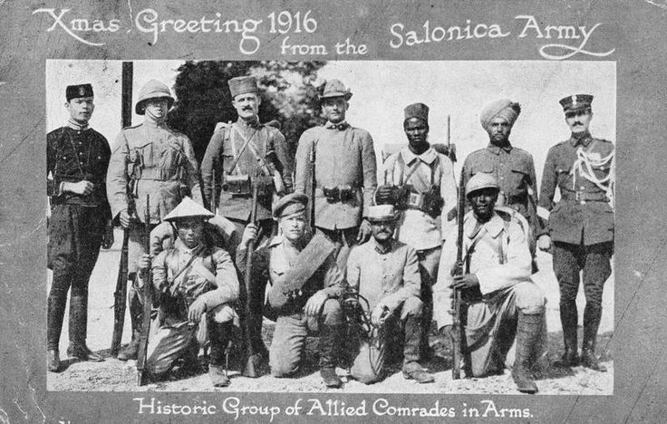The Salonika Army Christmas Card 1916 displaying soldiers of all Allied nations taking part in the campaign. From left to right standing: Montenegrin, British, Serbian, Italian, French Colonial Zouave, Indian, Greek. Kneeling: French Colonial Cochin Chinese, Russian, French, French Colonial.