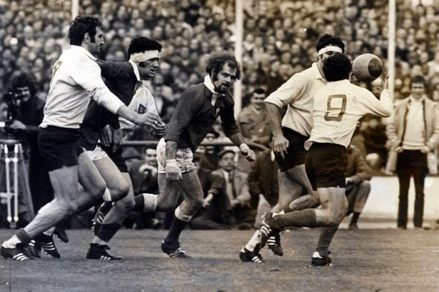Mervyn Davies and John Taylo swoop in on French scrum half Max Barrau in Paris, March 1971