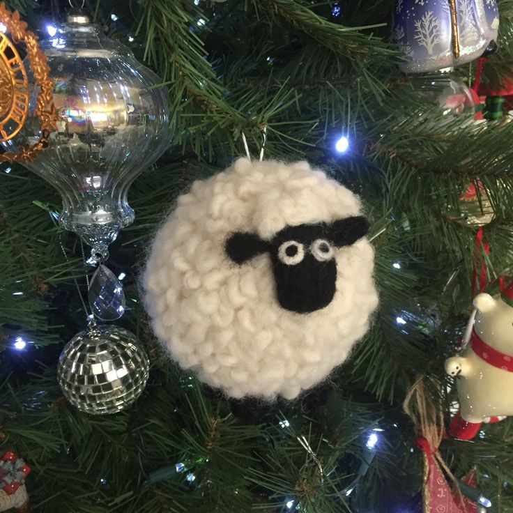"""Shirley the Sheep (from Shaun the Sheep) ornament - crocheted ball stuffed with polyfil, single-ply """"roving"""" yarn needle felted in for fleece, Needle felted head, ears, and eyes."""
