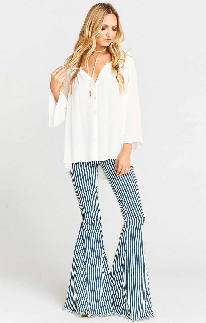 The highest ranked pull on super flares are here and ready to set you ahead of the curve. Suck you in in all the right places with the perfect amount of stretch so you always feel free. FINALLY you have a pair of high waisted jeans to wear your collection of Mumu crop tops with, as well as everything else in your closet. *65% Cotton, 33% Polyester, 2% Spandex *No pockets in front, 2 pockets in back *Stretchy elastic waist *Basically Wrinkle-proof. Throw in ...