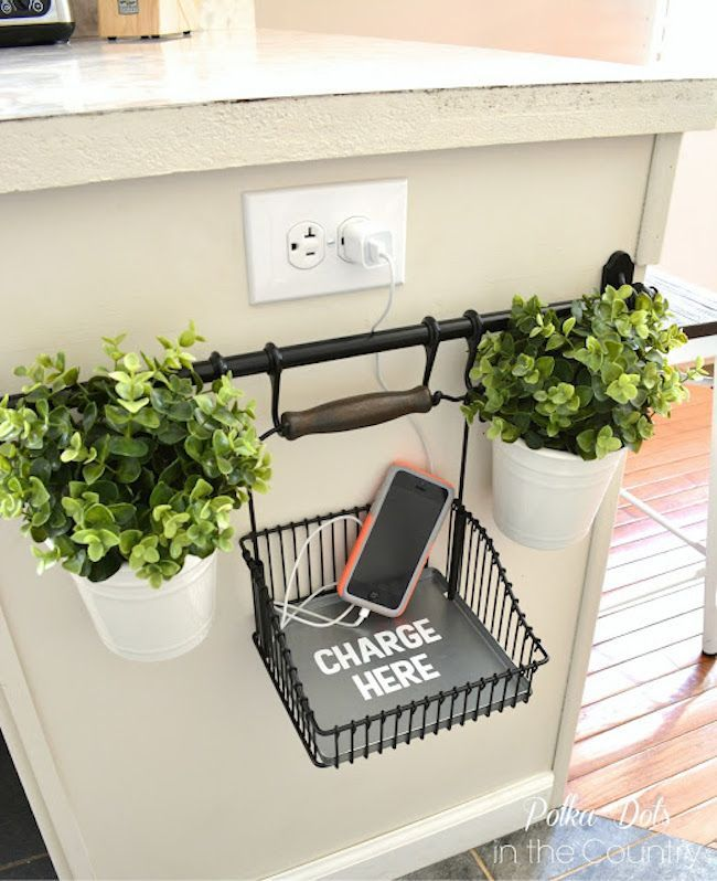 I love this - a charging area for guests!! I'd switch out these plants and replace them with thyme or Rosemary