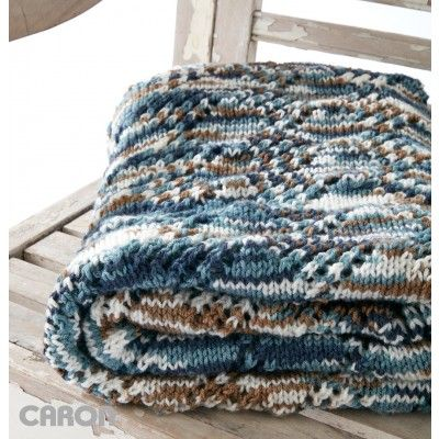Variegated Caron Jumbo yarn brings color and texture to the Crystal Lace Blanket Easily knit, this is a great pattern for beginners. | Yarnspirations |Free Beginner Blanket Knit Pattern