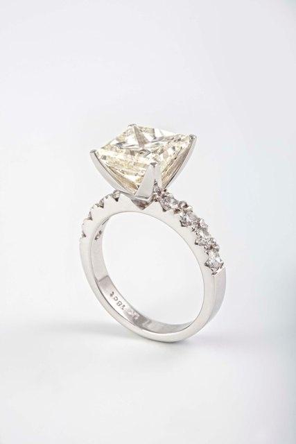 5.03ct Princess ring - with small diamonds.