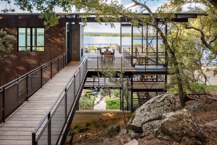 The top floor of this tall holiday home by US studio Lake Flato is situated above the tree line, enabling impressive views of a lake in Texas Hill Country.