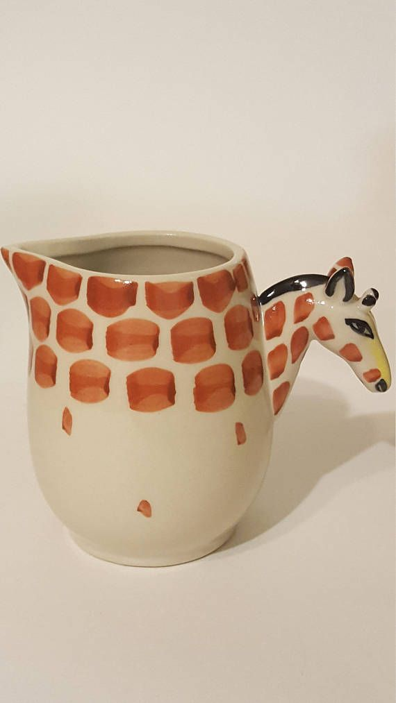 Check out this item in my Etsy shop https://www.etsy.com/ca/listing/566229100/vintage-giraffe-creamer-giraffe-home