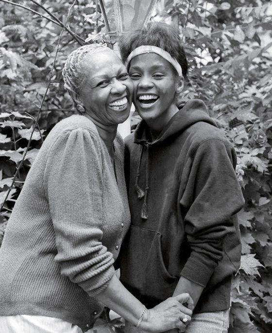 A teenage Whitney Houston embraces her mother Cissy Houston.