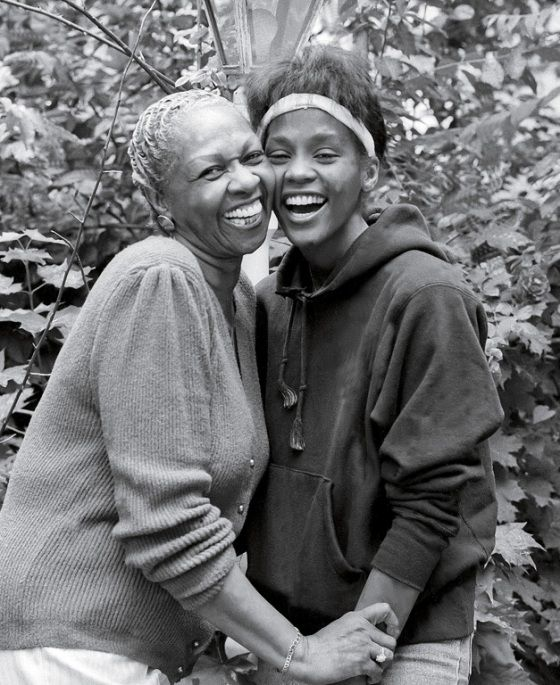 A teenage Whitney Houston embraces her mother Cissy Houston.