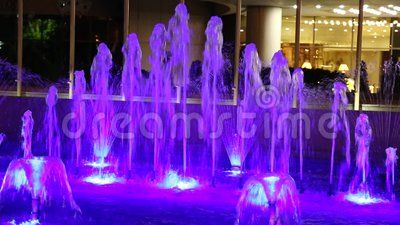 Fountain illuminated in blue decorative in the night.