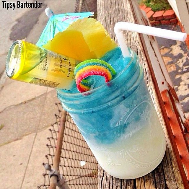 Tipsy Bartender LUCKY CHARMS White Layer- Coconut Vodka Coconut Syrup Ice Blend Blue Layer- Pineapple Vodka Blueberry Syurp Ice Blend Garnish- Pineapple Slices Rainbow Sour Candy Mini Ciroc Bottle