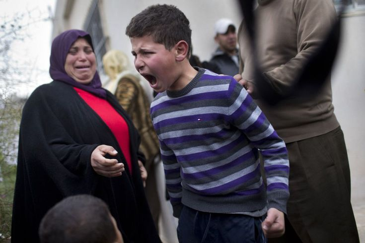 A Palestine boy cries desperately when finding that authorities demolish his house in Jerusalem after coming back from school. Photo by Bernat Amangue (Associated Press)