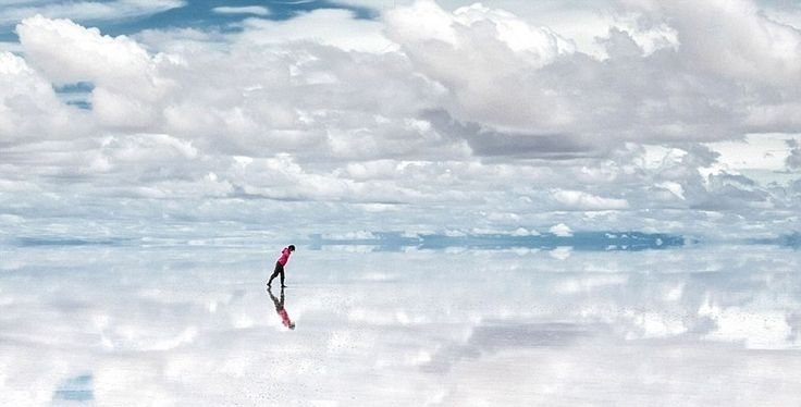 Salar de Uyuni Located in southwest Bolivia, near the crest of the Andes, it is covered by a few meters of salt crust, which has an extraordinary flatness with the average altitude variations within one meter over the entire area of the Salar. The large area, clear skies and exceptional surface flatness make the Salar an ideal object for calibrating the altimeters of Earth observation satellites.  When covered with water, this extraordinary place becomes one of the largest mirrors on Earth.