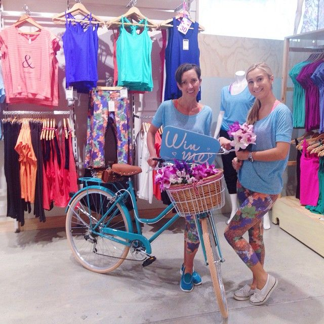The abi and joseph girls showing us the beautiful bike from Reid Cycles for our Win a Bike Competition