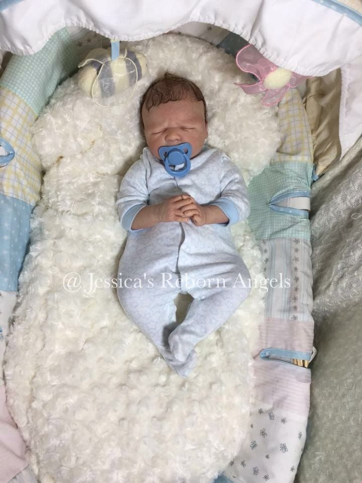 Baby George. Painted with ghsp and seal with matt varnish. Rooted mohair.