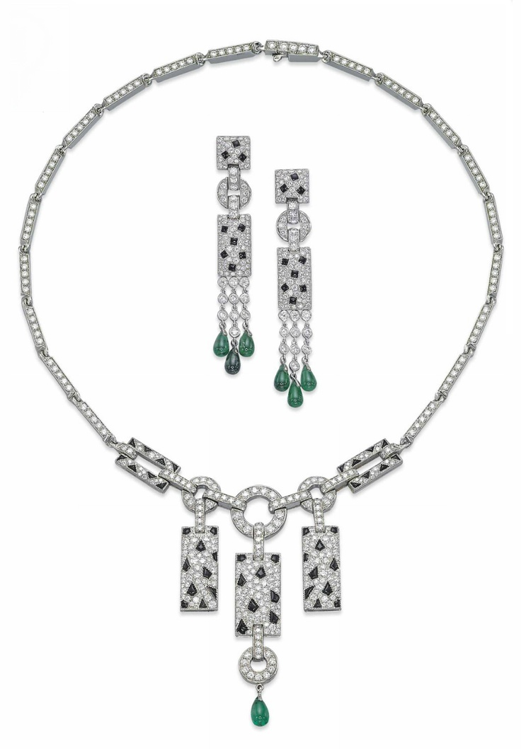 A SET OF ONYX, EMERALD AND DIAMOND 'PANTHER' JEWELLERY, BY CARTIER.  Comprising a necklace suspending at the front three rectangular pavé-set diamond panels with onyx spots, the central one with a drop-shaped emerald pendant, to the diamond-set loop-link top and bar-link neckchain, a pair of ear pendants en suite, necklace 39.5 cm, earrings 6.4 cm, with French assay marks for gold  Signed Cartier