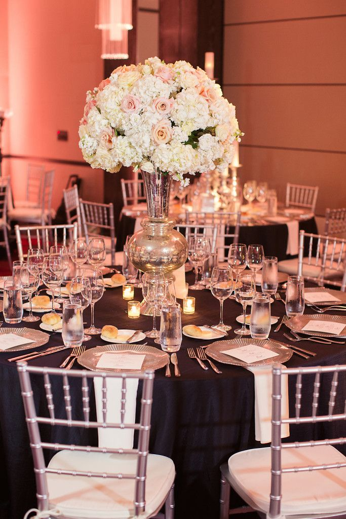 Summer black tie formal wedding guest tables with silver Chiavari chairs and large white floral centerpieces - Photo by Joshua Aull Photography