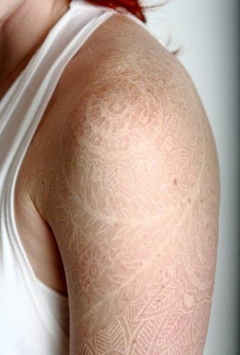 white ink tattoos on tan skin ... sunless tan lotion