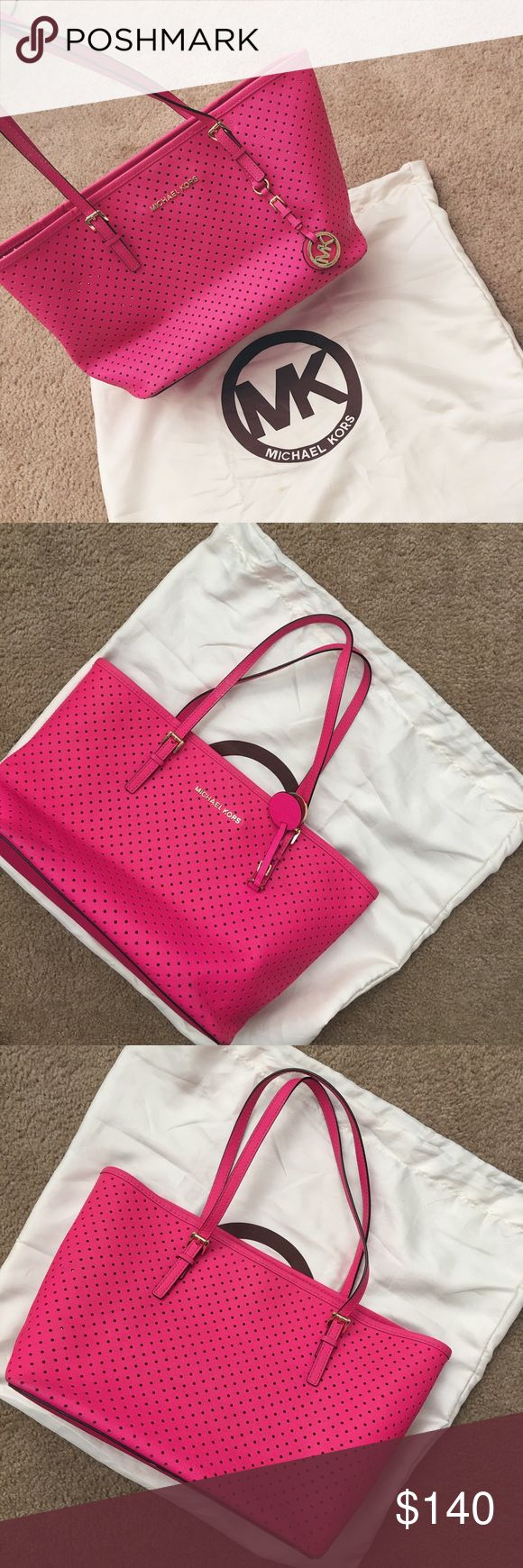 Authentic Michael Kors Perforated Small Tote Traded this on posh and I love it! But it doesn't fit all my stuff and to small for me unfortunately.. Color magenta , size small, does have a few spots on bottom of the bag and some pen marks on the pocket in the inside. Any questions just let me know! :) Michael Kors Bags Shoulder Bags