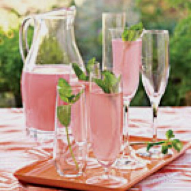 Sparking pink punch  1 (12-oz.) can frozen pink lemonade concentrate, thawed  4 cups white cranberry juice cocktail  1 qt. club soda, chilled  Garnish: fresh mint sprigs  -Southern Living wedding shower ideas    Sounds Yummy!