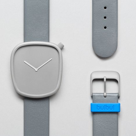 Pebble watch designed by KiBiSi for Bulbul. Grey and cyan blue with irregular face and corner knurled set dial.