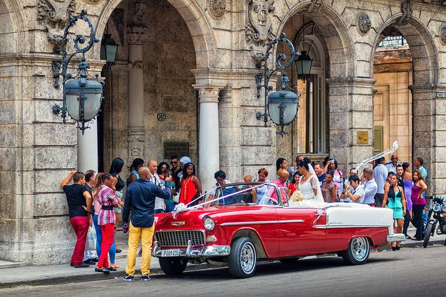 Husband and wife celebrating their wedding in Old Havana, Cuba. Regardless of the economic condition of the island or of individual families, Cubans know how to mark an occasion and celebrate milestones and events. Want the chance to witness a Cuban celebration? #VisitCuba