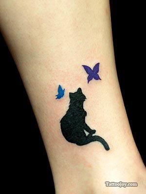 black cat silhouette playing with colored butterflies on the ankle