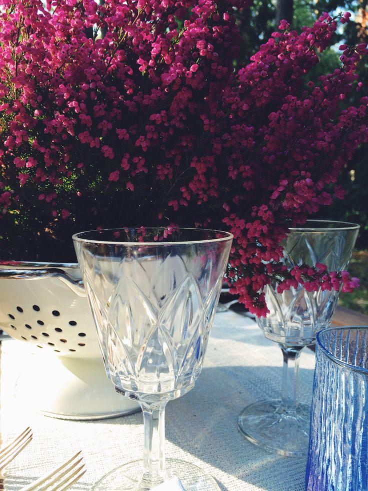 Blue tabletop. Vintage cutlery, outdoor dinner. Cristal glass.  Heather placed in colander - DIY inspiration.