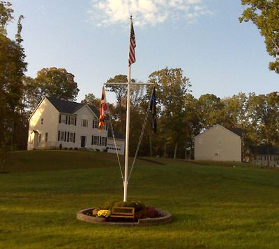 flag pole on house