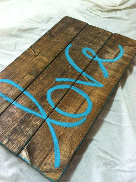 Love Wood Sign by RusticGraceuponGrace on Etsy, $24.99 OR break up an old palette and fix it to the wall behind your bed for an awesome headboard!