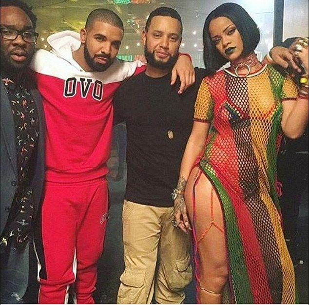 'Work': Rihanna  posted a picture to her Snapchat on Saturday morning posing with Drake while on set of her music video in Toronto; Drake (second from L), Director X (center) and Rihanna