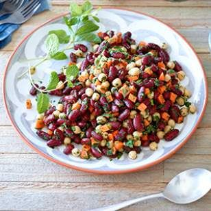 The bold flavors of the lemon-cumin dressing in this healthy bean salad recipe make it a wonderful side dish to grilled beef and lamb, yet it's also a stellar meatless main when served with whole-wheat couscous.