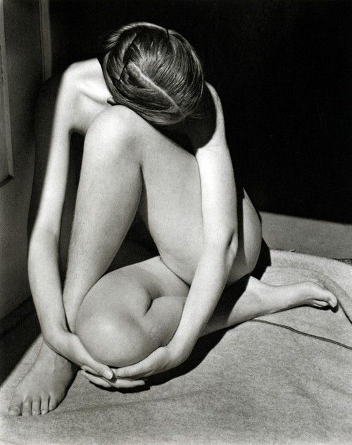 """Edward Weston, Nude. 1936  """"Edward was never happy with the shadow on the right arm and I was never happy with the crooked hair part and bobby pins. But when I see the picture unexpectedly, I remember most vividly Edward examining the print with a magnifying glass to decide if the few visible pubic hairs would prevent him from shipping it through the mail."""" Charis Weston Wilson"""