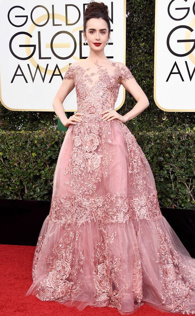 Lily Collins from Best Dressed at Golden Globes 2017  The vampy makeup paired with the youthful braided updo complements the romantic lace masterpiece that is her Zuhair Murad Couture gown in all the right ways!
