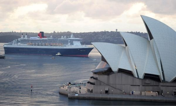 Queen Mary 2 sailing by Sydney Opera House. Further Cunard information http://bit.ly/zXddiB