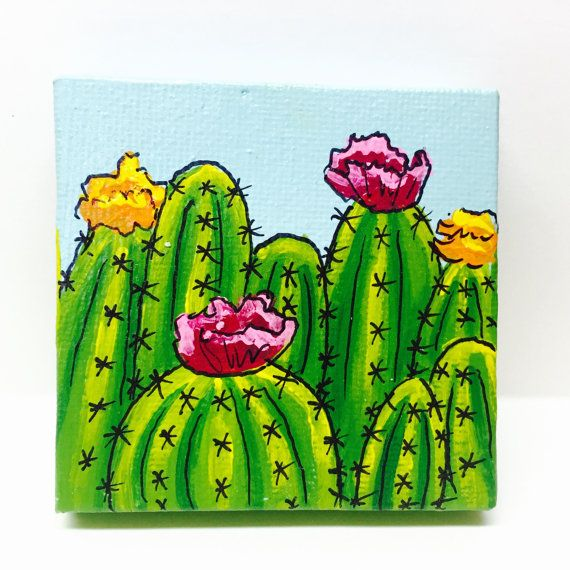 This fun and interesting miniature painting was created using a canvas measuring 3x3. It measures approximately 1/2 deep. The front features bright, happy, flowering cacti in acrylic paint on a light blue background. The painting has been sealed in a gloss sealer to protect the painting from UV and moisture damage.  Attached to the back are two strong magnetic strips, allowing the painting to be displayed on your fridge, locker, filing cabinet, or any other metal surface