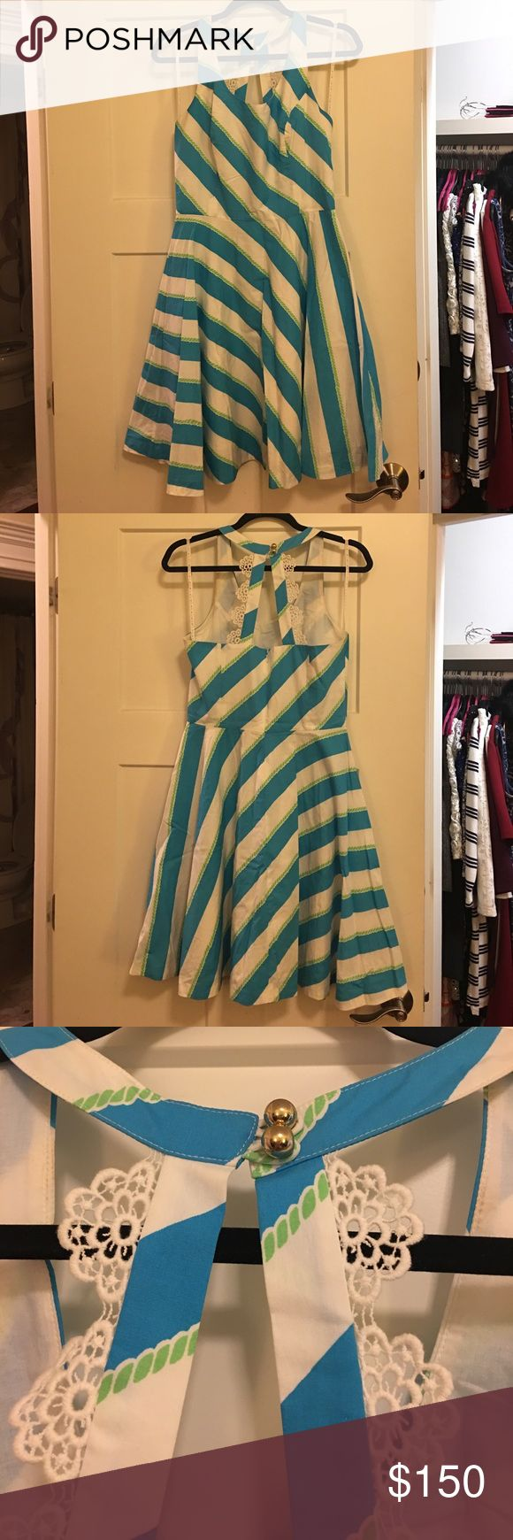 Lilly size 4 nautical spring dress! Super cute and lightweight, perfect spring dress with a fun fun flare! Nautical print - blue and aqua stripe with a green rope pattern. Back is very feminine, white lace appliqué and gold bead fasteners. Sorry for the wrinkles, been in the closet all winter!! Lilly Pulitzer Dresses
