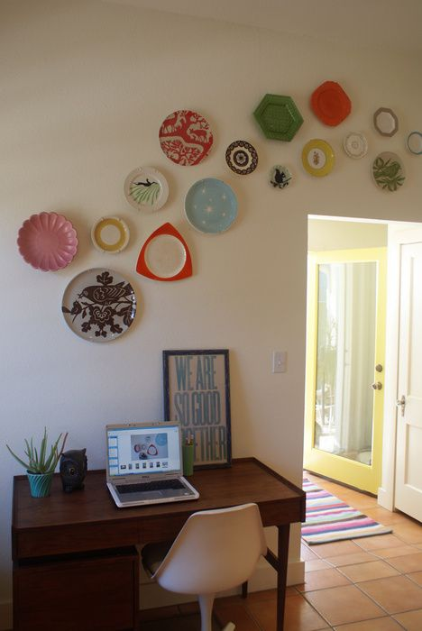 plate wall. Love this. I'm thinking you could use a lot of different elements. Like the collection of small mirrors I have.