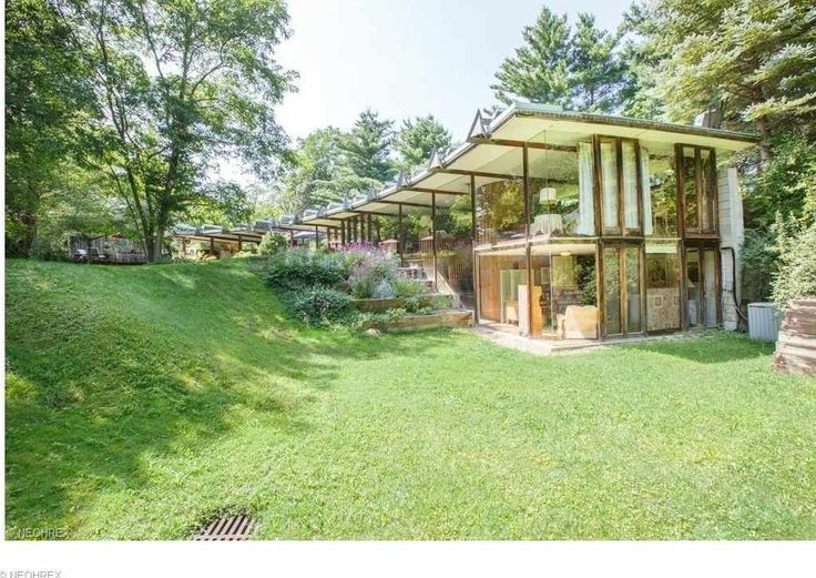 Looking for an Artist / Yoga Retreat Nestled on almost 6 Acres of Wooded Paradise? This Frank Lloyd Wright inspired design was built by John Terrance Kelly is the home for you! Enjoy Hardwood Floors throughout, Massive Full Walls of Glass that views Nature, 2 Full Unique Spa Showers/Baths. This Prairie-style mid-century modern home is full of personality and is currently owned by an Artist!