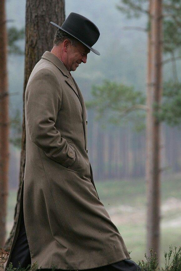 Foyle's War ~ Michael Kitchen as Christopher Foyle, hat on,  head down,  hands in pocket . . .