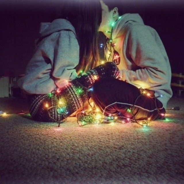 Cute couple in love wearing Christmas lights