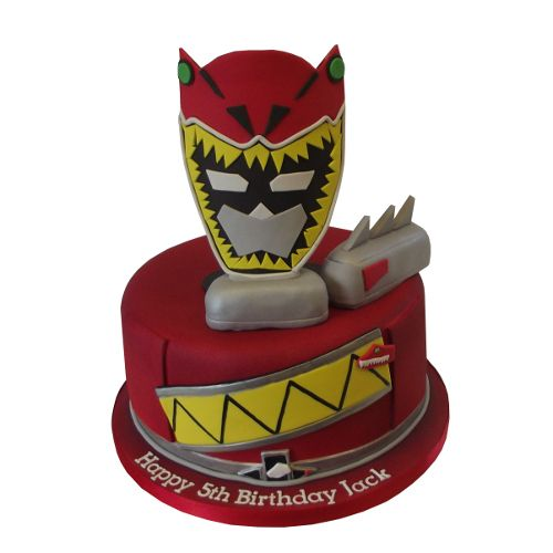 "<b>Power Rangers Cake</b><br />A 4"" deep cake, with am edible Mask, plus additional decorations made from Rice Krispie Treat. approx 40 Ptns, from £125"